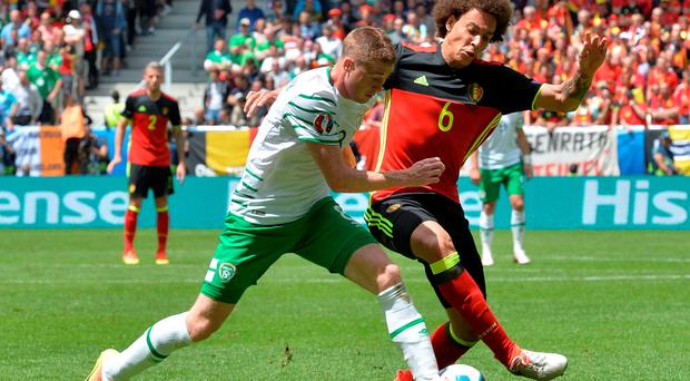 Ireland's midfielder James McCarthy (L) vies for the ball with Belgium's midfielder Axel Witsel during the Euro 2016 group E football match between Belgium and Ireland at the Matmut Atlantique stadium in Bordeaux on June 18, 2016. / AFP PHOTO / NICOLAS TUCATNICOLAS TUCAT/AFP/Getty Images