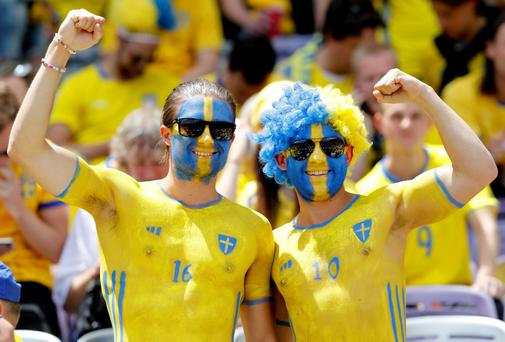 The beautiful game - football fans from around the world. Swedish supporters, their faces painted in the colors of the national flag, cheer as they wait for the start of the Euro 2016 Group E soccer match between Italy and Sweden at the Stadium municipal in Toulouse, France, Friday, June 17, 2016. (AP Photo/Antonio Calanni)