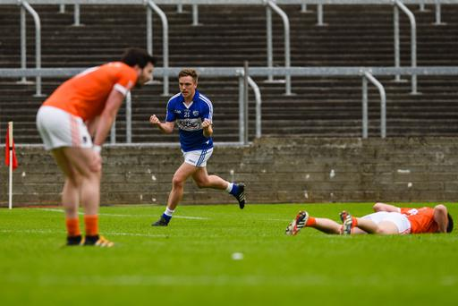 Orchard flattened: Armagh players are down and out as Jamie Farrell of Laois celebrates scoring the final point of the game at O'Moore Park