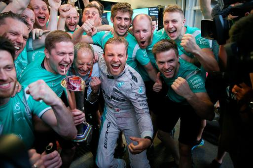 Team effort: Mercedes driver Nico Rosberg celebrates with his mechanics in the team garage after winning the Grand Prix of Europe in Azerbaijan