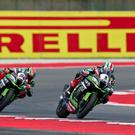 Wheely close: Jonathan Rea (1) duels with Kawasaki team-mate Tom Sykes, eventually overtaking him, to win the second World Superbike race in Misano, Italy