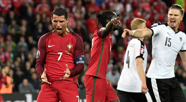 Silent star: Cristiano Ronaldo had nothing to shout about to the media after missing a penalty in Saturday's scoreless draw with Austria