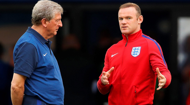 Top team: Wayne Rooney (right) wants England boss Roy Hodgson to be offered a new deal that will see him in charge for the forthcoming World Cup campaign