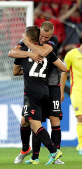 Winning feeling: Albanian players celebrate their victory over Romania