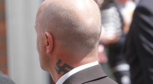 A marcher with a swastika tattoo takes part in a loyalist parade to mark the centenary of the Somme on Saturday. Picture Sunday Life