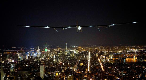 Solar Impulse 2 in the skies above New York yesterday. Photo: Jean Revillard/Getty Images