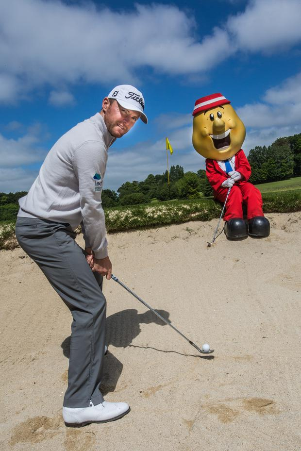Winning pair: Michael Hoey and Mr Tayto at Galgorm Castle Golf Club