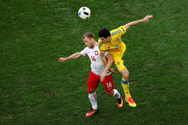 Poland's Jakub Blaszczykowski, left, and Ukraine's Taras Stepanenko challenge for the ball during the Euro 2016 Group C soccer match between Ukraine and Poland at the Velodrome stadium in Marseille, France, Tuesday, June 21, 2016. (AP Photo/Claude Paris)