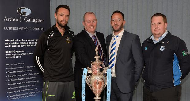On the draw: Nigel Jones (left), captain of holders CIYMS, with Muckamore's Neil Gill (third left) and Carrick's Gary Thompson - one of the sides CI could meet in the semi-finals of the Northern Cricket Union's Arthur J. Gallagher Senior Challenge Cup. They are pictured with Gordon Markey, Broking Director of Arthur J Gallagher