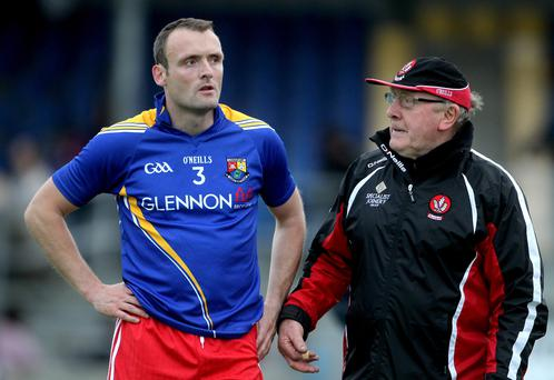 Down and out: Eamonn Burns and his Mournemen will hope to avoid the experience of John Brennan and Paddy Bradley who have tasted defeat to Longford in the qualifiers