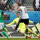 Saved again: Northern Ireland goalkeeper Michael McGovern keeps out German star Thomas Muller's shot, one of a number of outstanding saves he made to help his team make the last 16 of Euro 2016
