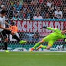 Glove affair: Michael McGovern keeps out an effort from Germany's Mario Gomez