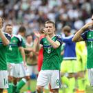 Great support: Northern Ireland players thank the fans after their 1-0 defeat to Germany at the Parc des Princes in Paris yesterday