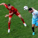 Czech Republic's Tomas Necid, left, and Turkey's Hakan Balta, right, challenge for the ball during the Euro 2016 Group D soccer match between the Czech Republic and Turkey at the Bollaert stadium in Lens, France, Tuesday, June 21, 2016. (AP Photo/Darko Vojinovic)