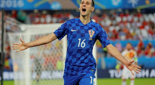 Croatia's Nikola Kalinic celebrates after scoring his sides first goal during the Euro 2016 Group D soccer match between Croatia and Spain at the Nouveau Stade in Bordeaux, France, Tuesday, June 21, 2016. (AP Photo/Manu Fernandez)