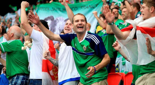 Northern Ireland fans continue to celebrate despite defeat well after the final whistle is blown, during the UEFA Euro 2016, Group C match at the Parc Des Princes, Paris. Mike Egerton/PA Wire.