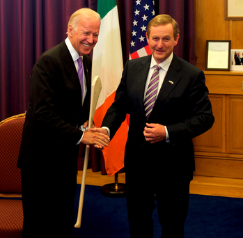 American vice-president Joe Biden (left) receives a hurley as a gift from Taoiseach Enda Kenny during a welcome ceremony at the Government Buildings in Dublin. Photo: Paulo Nunes dos Santos/AFP/Getty Images