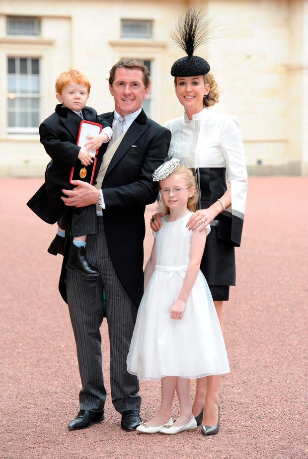 Former champion jockey Sir Anthony McCoy, with family wife Chanelle, daughter Eve and son Archie, after he was made a Knight Bachelor by the Princess Royal during an investiture ceremony at Buckingham Palace, London. PRESS ASSOCIATION Nick Ansell/PA Wire