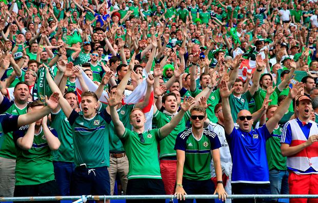 Northern Ireland fans celebrate after the final whistle at the Northern Ireland game at the Parc Olympique Lyonnais, Lyon