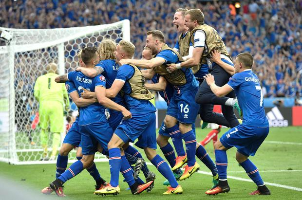 Iceland players celebrate a goal by Iceland's Arnor Ingvi Traustason during the Euro 2016 Group F soccer match between Iceland and Austria at the Stade de France in Saint-Denis, north of Paris, France, Wednesday, June 22, 2016. (AP Photo/Martin Meissner)
