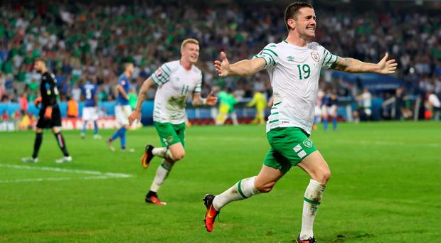 Republic of Ireland's Robbie Brady celebrates scoring his side's first goal of the game during the Euro 2016, Group E match at the Stade Pierre Mauroy, Lille. PRESS ASSOCIATION Photo. Picture date: Wednesday June 22, 2016. See PA story SOCCER Republic. Photo credit should read: Chris Radburn/PA Wire. RESTRICTIONS: Use subject to restrictions. Editorial use only. Book and magazine sales permitted providing not solely devoted to any one team/player/match. No commercial use. Call +44 (0)1158 447447 for further information.