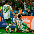 Get in: Robbie Brady celebrates scoring the winner with his team-mates James McClean (centre) and Shane Long