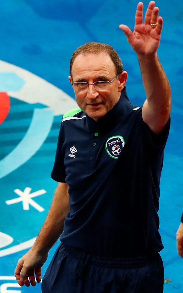 Republic manager Martin O'Neill applauds his team's supporters after his team's 1-0 win against Italy