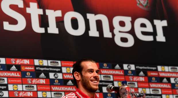 All smiles: Gareth Bale is dreaming of winning the Euros with Wales but insists he's focused on the last 16 clash against Northern Ireland