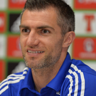 In it together: Aaron Hughes is being followed around France by his family