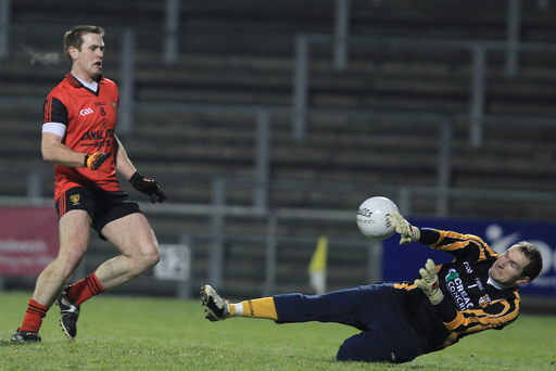 Solid: Sean O'Neill in action for Antrim in 2011, but he has now been drafted in as a midfielder