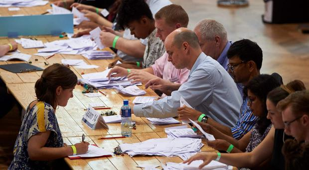 Vote counting staff sort ballot papers at a vote counting centre at The Royal Horticultural Halls in central London. Bookies have confirmed the poll has broken betting records for non-sporting event.