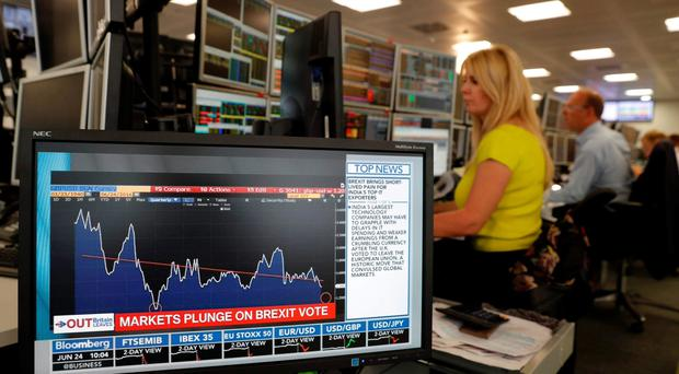 Traders from ETX Capital work in central London on June 24, 2015 following the announcement of the EU referendum. Pic AFP PHOTO / ADRIAN DENNISADRIAN DENNIS/AFP/Getty Images