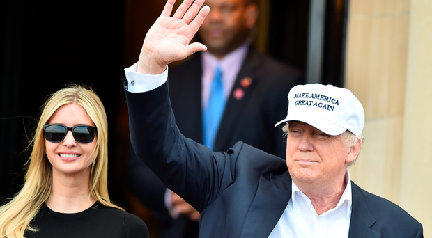 Presumptive Republican nominee for US president Donald Trumpwaves with his daughter Ivanka Trump on June 24, 2016 in Ayr, Scotland. Photo by Jeff J Mitchell/Getty Images