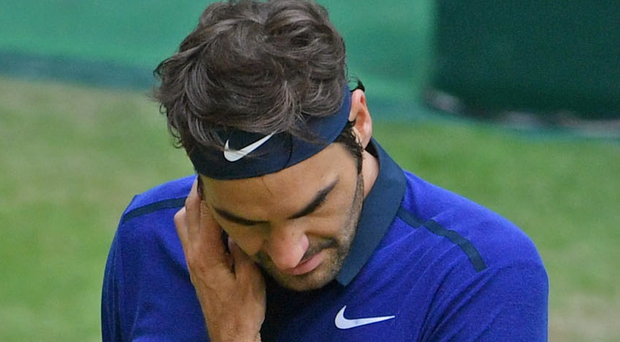 Roger Federer reacts in his half final match against Alexander Zverev in Halle, Germany.