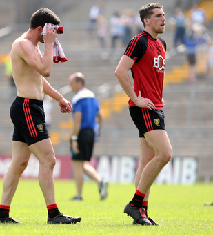 Misery: Down's Damian Turley is dejected after his side's Ulster quarterfinal defeat to Monaghan