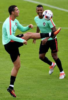 High hopes: Cristiano Ronaldo and Nani warm up for Croatia test