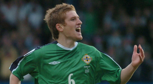 Happy memories: Steven Davis celebrates his first goal for NI against Wales in 2005