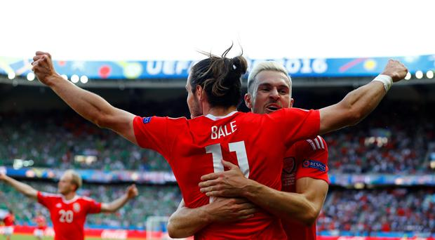 PARIS, FRANCE - JUNE 25: Gareth Bale (L) and Aaron Ramsey (R) of Wales celebrate their team's first goal during the UEFA EURO 2016 round of 16 match between Wales and Northern Ireland at Parc des Princes on June 25, 2016 in Paris, France. (Photo by Clive Rose/Getty Images)