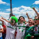 PARIS, FRANCE - JUNE 25: Fans of Northern Ireland celebrate near the Eiffel Tower before the football match between Wales and Northern Ireland during UEFA Euro 2016 tournament on June 25, 2016 in Paris, France. Wales edged Northern Ireland in the Round of 16 at Parc des Princes in Paris. (Photo by Brendan Hoffman/Getty Images)