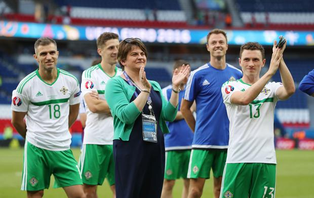 First Minister Arlene Foster with Northern Ireland players after the final whistle after being defeated by Wales 1-0 in Saturday evenings last 16 of the Euro 2016 tournament at the Parc des Princes, Paris. Press Eye - Belfast - Northern Ireland - 25th June 2016 - Photo by William Cherry