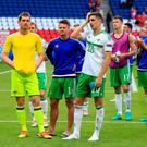 Northern Ireland's (l-r) goalkeeper Michael McGovern, Oliver Norwood and Craig Cathcart during the round of 16 match at the Parc de Princes, Paris. Jonathan Brady/PA Wire.
