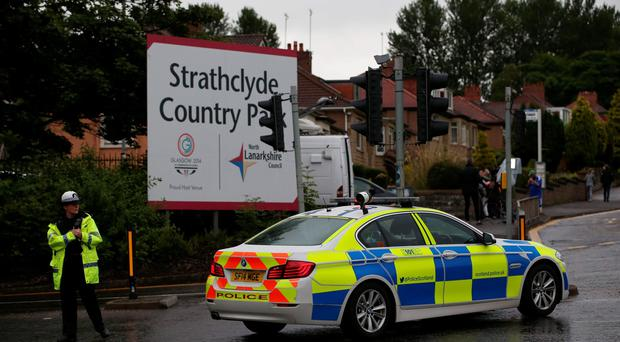 Emergency services at Strathclyde Country Park following a rollercoaster crash at the M&D's amusement park in Motherwell, near Glasgow. Jane Barlow/PA Wire