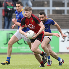 Breaking through: Conor Maginn of Down gets away from Longford duo Darren Gallagher and Diarmuid Masterson at Pairc Esler