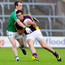 Hands on: Fermanagh ace Ruari Corrigan tackles Wexford's Syl Byrne
