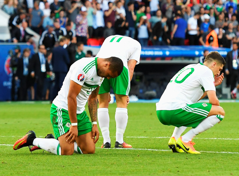 Josh Magennis, Conor Washington and Craig Cathcart are crestfallen as the final whistle sounds on Saturday's defeat to Wales