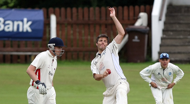 On target: Ryan Eagleson, who took two wickets, bowling for Carrickfergus in their Premier League defeat against Waringstown at The Lawn. Waringstown yesterday followed up with a bowl-out success to reach the semi-finals of the O'Neill's Ulster Cup