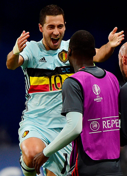 In control: Eden Hazard sparked into life as Belgium reached the quarters