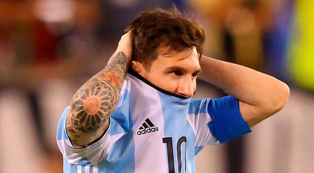 ionel Messi of Argentina looks on before the game winning penalty kick is made during the Copa America Centenario Championship match at MetLife Stadium on June 26, 2016 in East Rutherford, New Jersey. Chile defeated Argentina 4-2 in penalty kicks. (Photo by Mike Stobe/Getty Images)