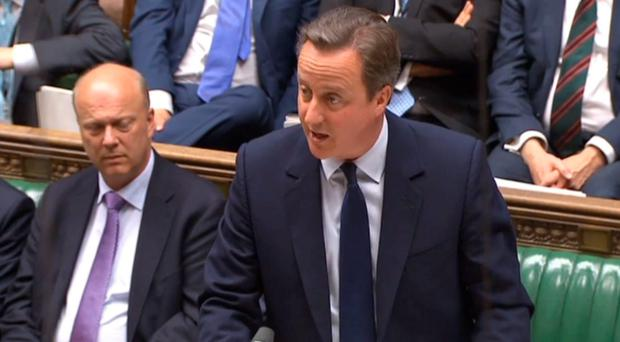 Prime Minister David Cameron makes a statement to MPs in the House of Commons. PA Wire