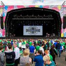 Northern Ireland fans at the Titanic Fanzone stage ahead the Northern Ireland team homecoming to Belfast from the 2016 Euro Championship in France. PRESS ASSOCIATION Photo. Picture date: Monday June 27, 2016. See PA story SOCCER N Ireland. Photo credit should read: Liam McBurney/PA Wire